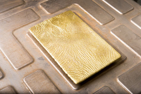 futures: New shiny golden ingot at a factory