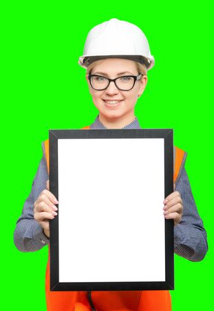 vest in isolated: Isolated female worker portrait on the green background Stock Photo