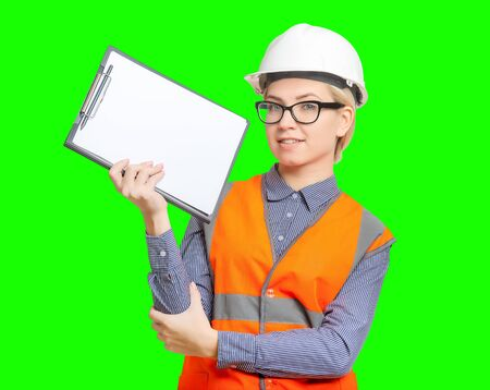 Isolated female worker portrait on the green background Stock Photo