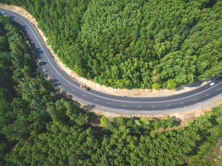 Drone view on the road in the forest Standard-Bild
