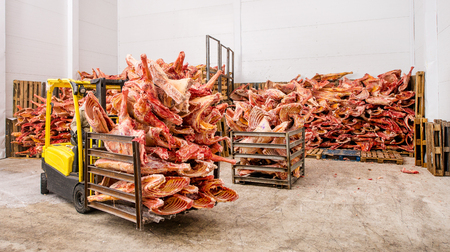 Stored frozen meat at a meat factory before processing 写真素材