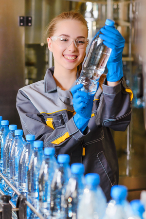 Specialist in factory checking bottles