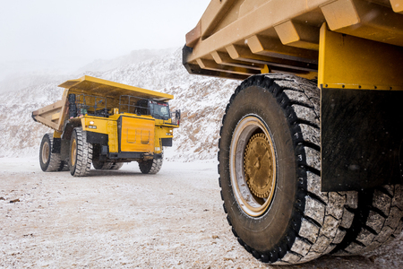 heavy snow: Big yellow mining truck