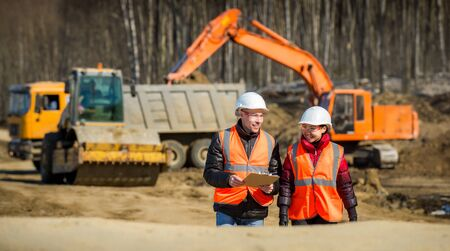Road workers inspecting construction Stock Photo