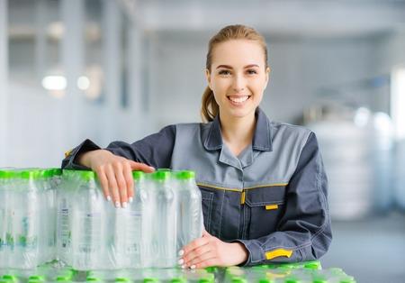 Worker with bottled water Standard-Bild