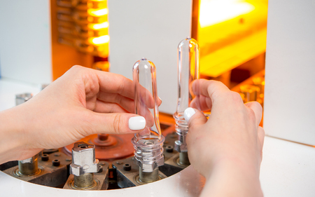 Plastic bottle making process Banco de Imagens
