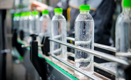 Conveyor with water bottles Banco de Imagens