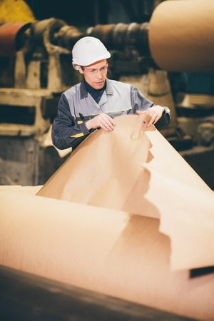 papermaking: paper mill factory worker