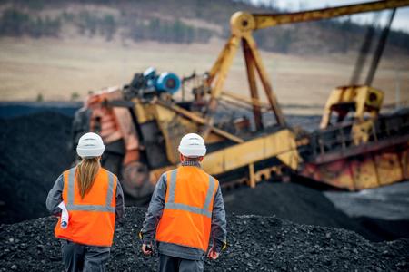 Coal mine workers in an open pit Reklamní fotografie