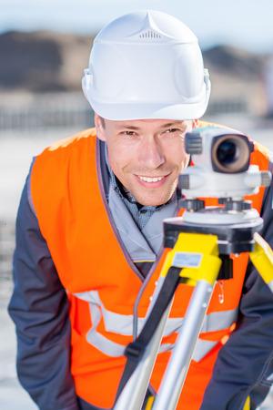 Surveyor with theodolite level Imagens