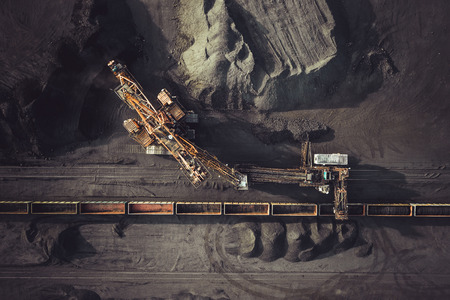Coal mining. Aerial view. Excavator loading train cargos 版權商用圖片 - 81510592
