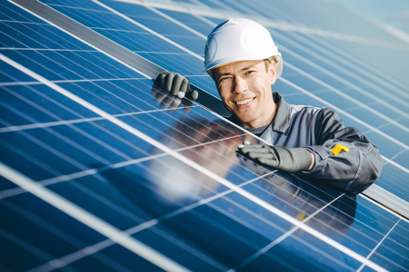 A male technician at a solar power station
