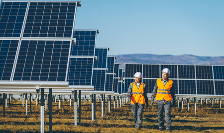 Technicians at a solar power station