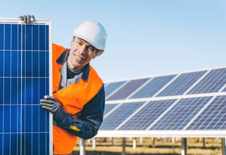 electricity export: A male technician at a solar power station