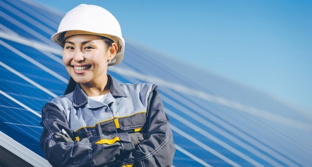 A woman at the solar panel of a solar power station