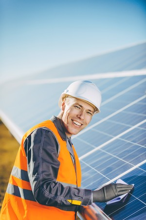 A man at the solar panel of a solar power station