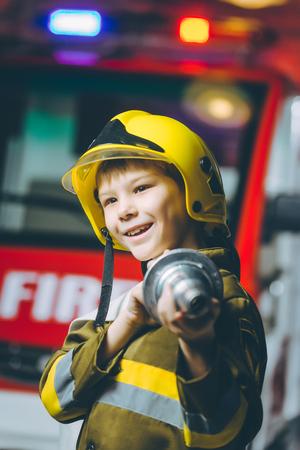 Child Firefighter play Banco de Imagens