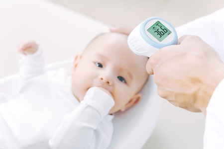 baby temperature measurement thermometer Stock Photo