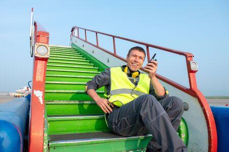 airport worker radio coordinate control ladder terminal