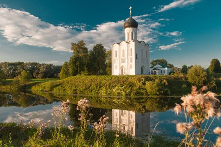 Church of the Intercession of the Mother of God on the Nerl. Ancient Russian Church shot in summer evening, at sunset