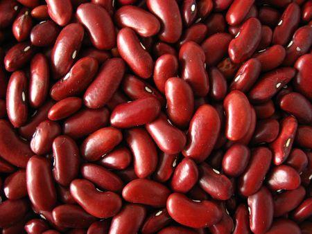 frijoles rojos: De color rojo profundo fondo de frijol. Los alimentos org�nicos. Foto de archivo