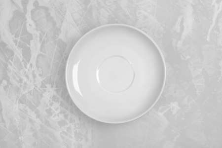 delftware: round empty plate in the center of the old white table