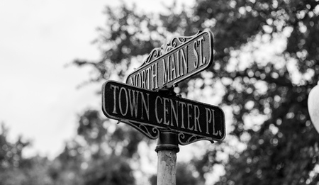 Town center street sign in center of town Black and White