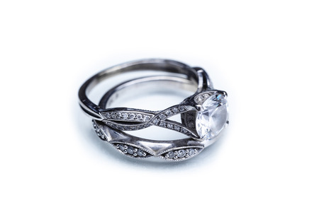 Engagement ring and wedding band on white background 版權商用圖片