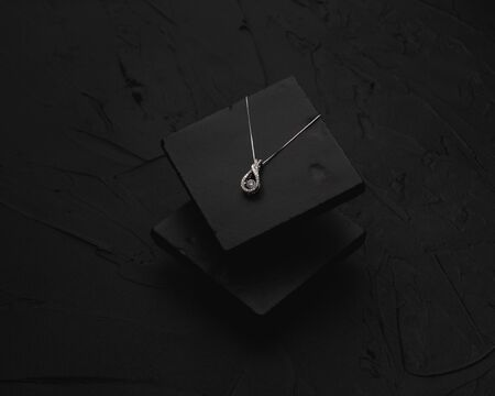 Diamond necklace on black slate isolated  background.
