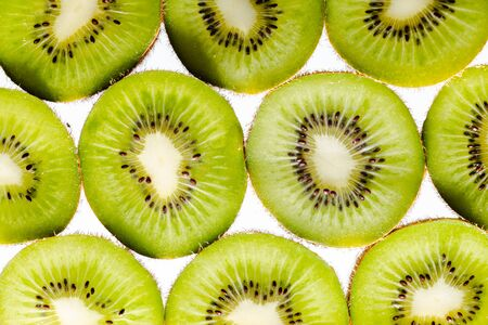 Sliced kiwi fruit flatlay background on white. Healthy eating. 版權商用圖片
