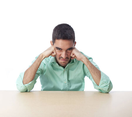 irritate: Angry man leaning on a table