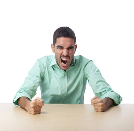 irritate: Angry guy pounding a table Stock Photo
