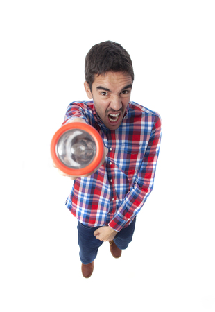 Frightened guy with a flashlight photo