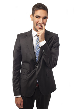 enterprising: Businessman with finger in the nose