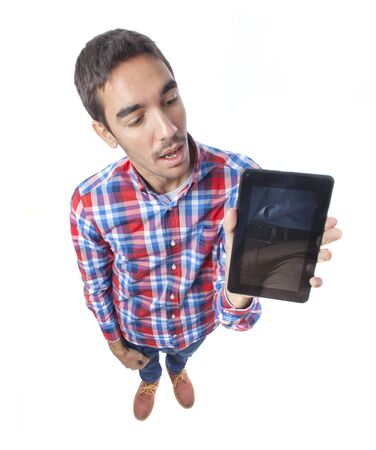 Surprised guy holding a tablet photo