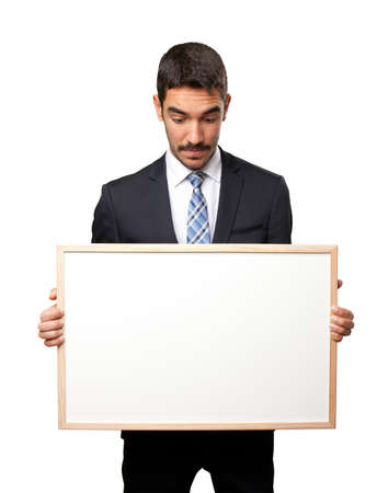 namecard: Shocked businessman holding a namecard Stock Photo