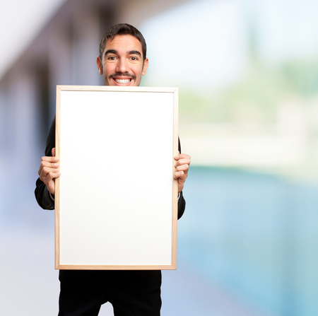 glad: Glad businessman holding a name card Stock Photo