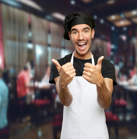 okay: Happy chef saying okay Stock Photo