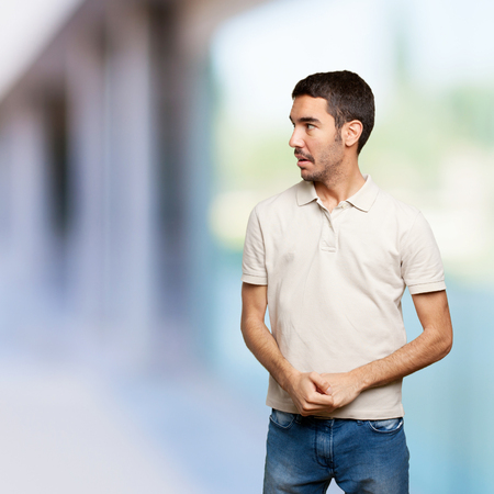 Scared young man Stock Photo