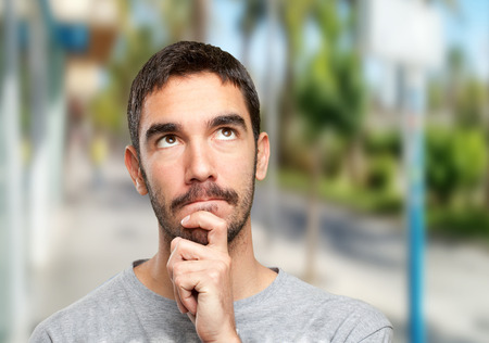 wondering: Close up of a guy wondering Stock Photo