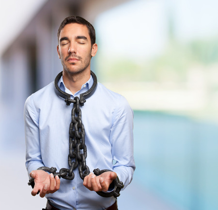 puppet master: Chained businessman Stock Photo