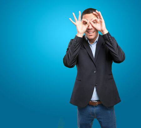 Happy businessman with observation gesture