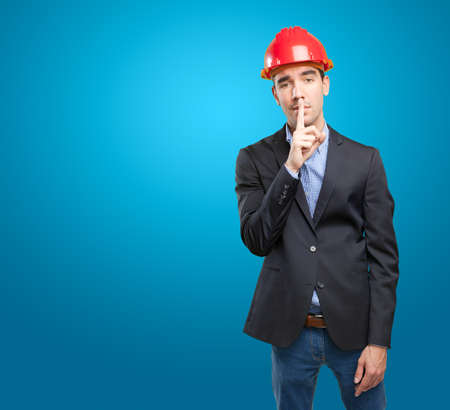 silence gesture: Serious architect with silence gesture Stock Photo