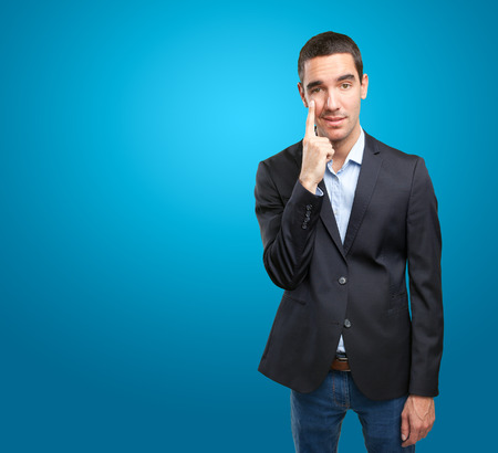 observe: Confident businessman with observe gesture Stock Photo
