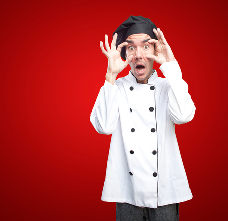 observe: Shocked chef with observe gesture