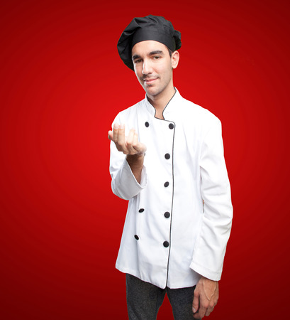 invitando: Cocinero feliz invitando a venir
