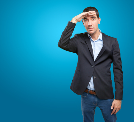 observe: Astonished businessman with observe gesture Stock Photo