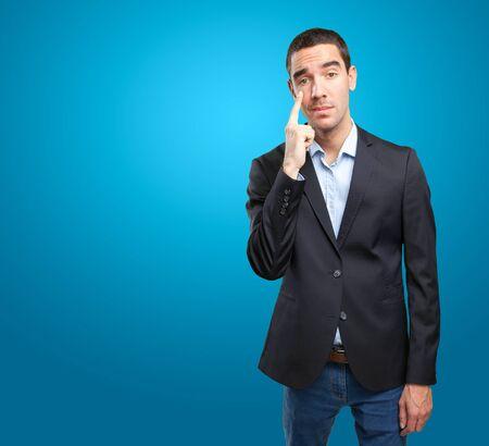 observation: Worried businessman with observation gesture