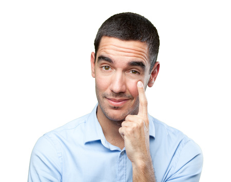 observation: Close up of a young man with observation gesture