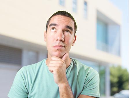wondering: Happy young man wondering